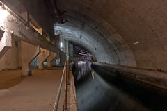 Underground repair base of military submarines. Stock Photography
