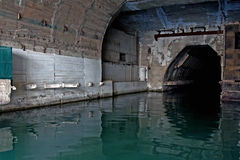 Underground repair base of military submarines. Royalty Free Stock Photos