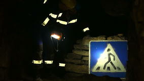 Underground researchers climb in an underground tunnel. Passage by road signs. Underground researchers climb in an underground tunnel. Abandoned quarries under stock video