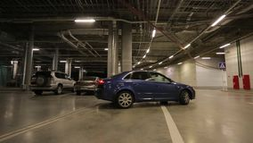 Underground road. Car drives out of the underground parking stock video footage
