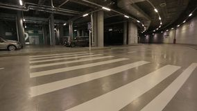 Underground road. Cars are underground parking spaces at the Palace of Sports, underground road stock video footage