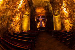 Underground salt cathedral Zipaquira main room. With big cross and benches in blue light near Bogota, Colombia Royalty Free Stock Image