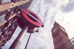 Underground sign and Big Ben. London, UK Royalty Free Stock Image