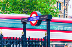 Underground Sign and Double Decker in Motion. London, UK - June 7, 2016 - Underground sign and double decker in motion at Charing Cross Stock Image