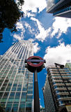 Underground sign and skyscrapers, Canary Wharf Stock Photo