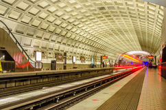 Underground Station with a Departing Train Royalty Free Stock Photography