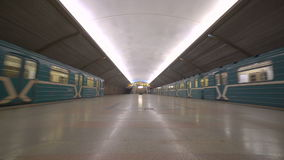 Underground station in Moscow with two passing trains. Two trains leaving the undeground station stock video footage