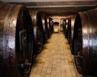 Underground storage with old wooden barrels. Wine cellar with old wooden barrels of wine Royalty Free Stock Image