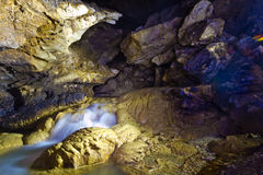 Underground stream in flooded cave Head of Otap Royalty Free Stock Images