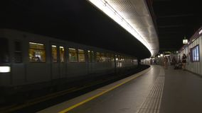 Underground train arrives to a platform stock footage