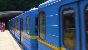 Underground train in blue and yellow arrives at the metro station in Kiev. Ukraine. Underground train in blue and yellow arrives at the metro station in Kiev stock footage