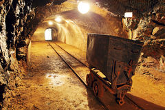 Underground train carts in gold, silver mine royalty free stock photos