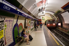 Underground train enters Piccadilly Circus Stock Image