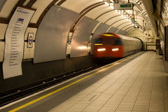 Underground train enters Regents Park Station Stock Image