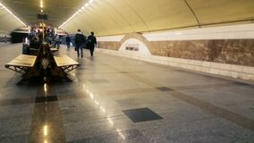 Underground train leaving metro station, people travel by urban public transport. Stock footage stock footage