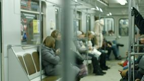 Underground transport in the city. Metro arrives at the station. People in a subway. Underground transport in the city stock video footage