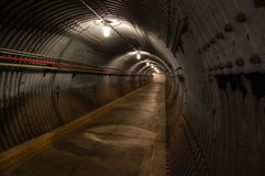 Underground tunnel. Escape tunnel in an underground bunker Royalty Free Stock Image
