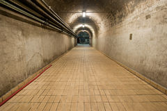 Underground Tunnel. Long underground tunnel with power lines Royalty Free Stock Photography