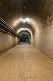 Underground Tunnel. Long underground tunnel with power lines Royalty Free Stock Images