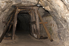 Underground tunnel. Old derelict mine. Tunnel entrance Royalty Free Stock Photography