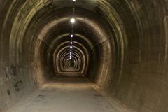 Underground tunnel at Alpe Adria cycle ath. Underground tunner, old railway, alpe adria road , bicycle road , north italy stock photography