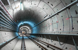 Underground tunnel with blue lights Stock Photos