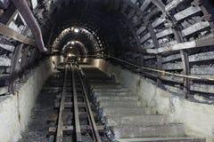 Underground tunnel in the coal mine. Illuminated, Underground Tunnel in the Mine Royalty Free Stock Photos