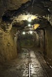 An underground tunnel in a copper mine. An underground rail tunnel in a copper mine Royalty Free Stock Image