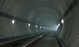 Underground tunnel with lights Stock Photo