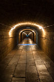 Underground tunnel. An underground passage under the Gatchina Palace stretching from the palace itself to the Silver lake in a palace park. Gatchina, Russia Stock Photos