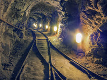 Underground tunnel with train tracks. Royalty Free Stock Photos