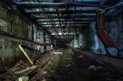 Underground communication tunnel. Underground tunnel under the abandoned factory royalty free stock images