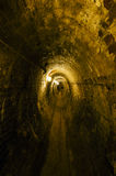 Underground Tunnels Under Brewery in Over-the-Rhine, Cincinnati. Dark underground tunnels, lined with limestone rock walls and bricks, were used as storage and Royalty Free Stock Photography