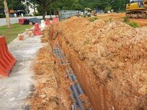 Free Underground Utility And Services Pipe Laid By Workers In The Trenches At The Construction Site. Royalty Free Stock Images - 187399809