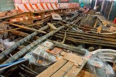 Underground utility repairs. A New York City street is uncovered to repair underground utilities stock photos