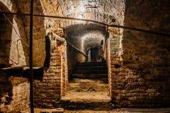 Underground vaulted cellar of red brick under old mansion.  Royalty Free Stock Photo