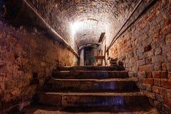 Underground vaulted cellar of red brick under old mansion.  Royalty Free Stock Photos