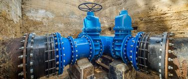 Underground water supply system. Large valves.n. Large valves on the pipeline. Underground water supply system royalty free stock images