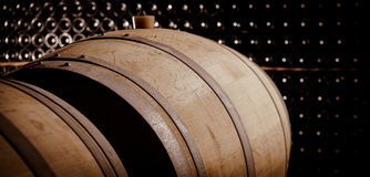 Underground wine cellar, Wooden barrels, bottles storage, Royalty Free Stock Photography