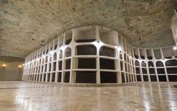 Underground winery, bottles in cellars stock photos