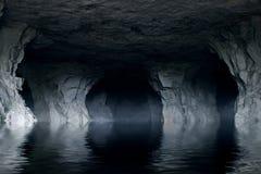 Underjordisk flod i en mörk stengrotta Arkivbilder