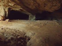 Underjordisk grottaingång Fotografering för Bildbyråer