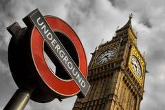 Underjordiska och stora Ben i London Fotografering för Bildbyråer