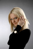 Undermine look. There is serious women looks at you. She wear black jeans and black sweater royalty free stock photos