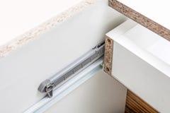 Undermount Drawer Slides - glides closeup detail - Furniture hardware Royalty Free Stock Image