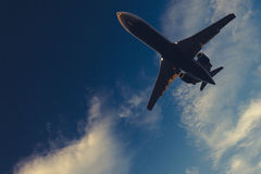 Underneath Airplane with pretty blue sky in background Royalty Free Stock Photography