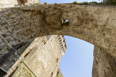 Underneath of arched stone passage at Sarzanello fortress, Sarza Stock Photo