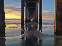 Underneath Beach Pier at Sunset with Colorful Sky, La Jolla, CA Stock Photos