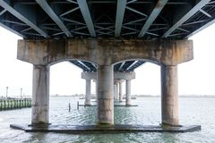 Underneath the bridge in New Jersey. The support pylons underneath the Brigantine Bridge in New Jersey stock photography