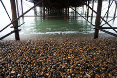 Structure Underneath Brighton Pier. Structure and supports of the underside of Brighton Pier royalty free stock photos